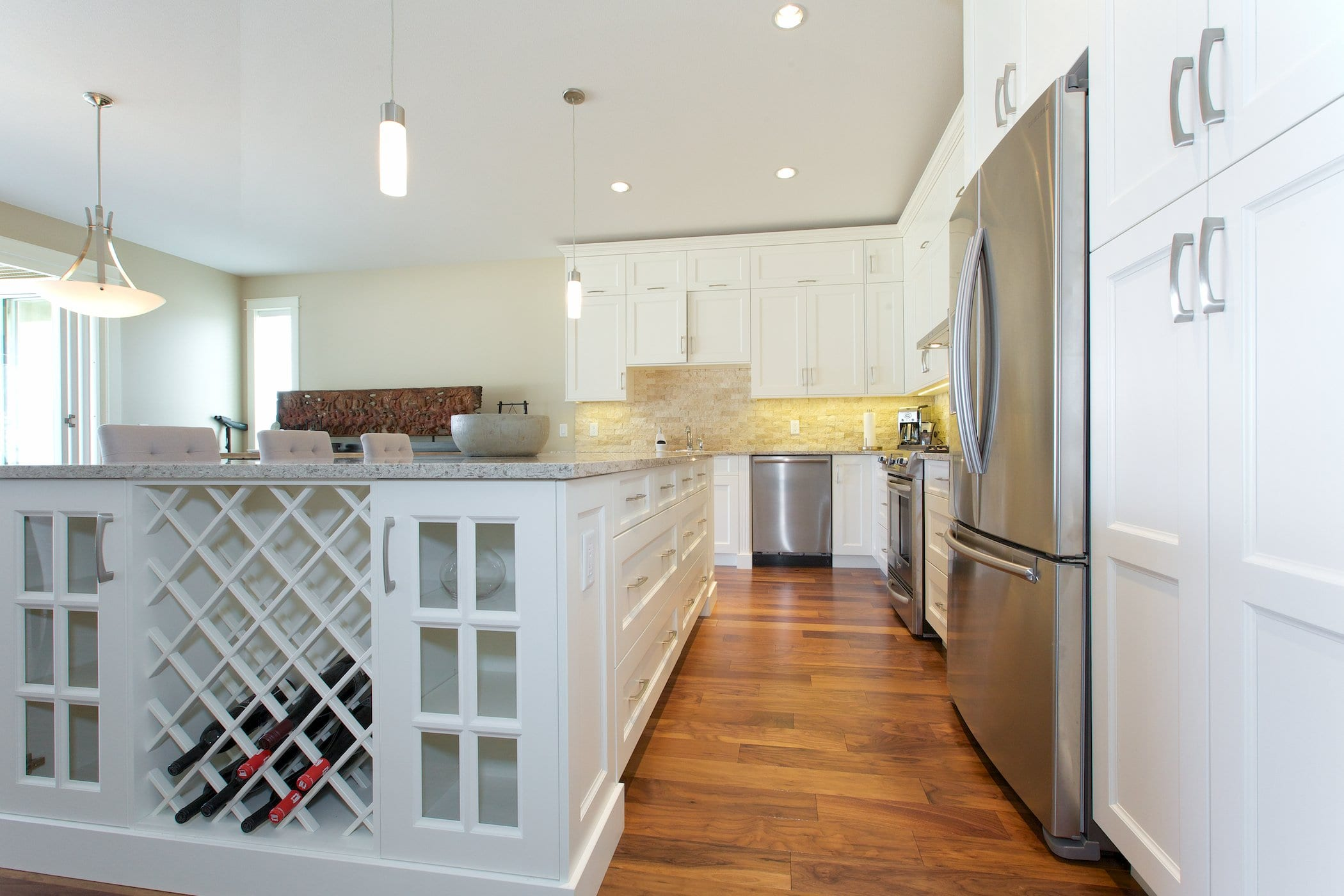 interior shot of west harbour home kitchen with white cabinetry fridge freezer stove and dishwasher