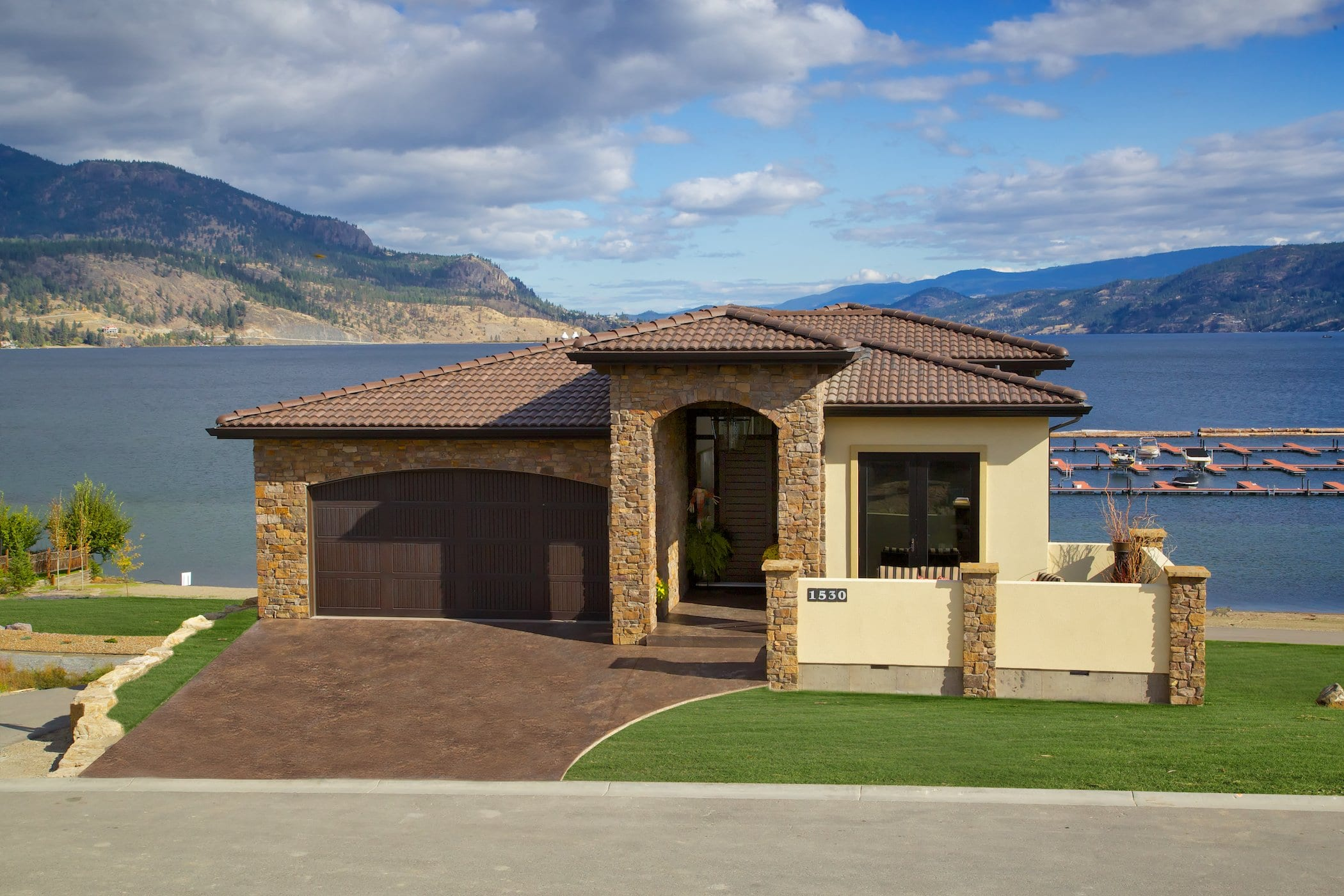 exterior shot of west harbour cream coloured house with lakeview of the okanagan
