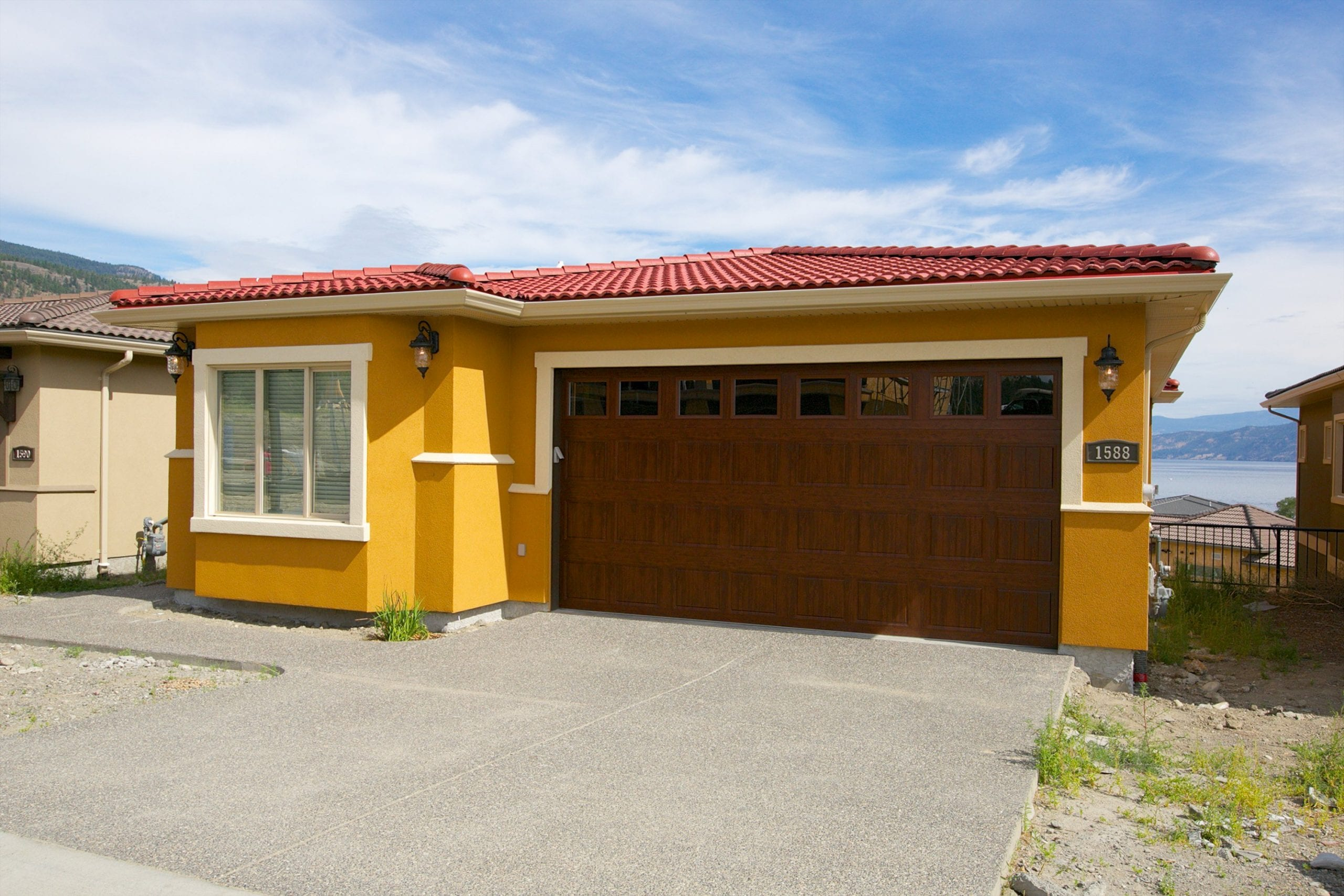 exterior shot of butterscotch coloured west harbour home with a red roof